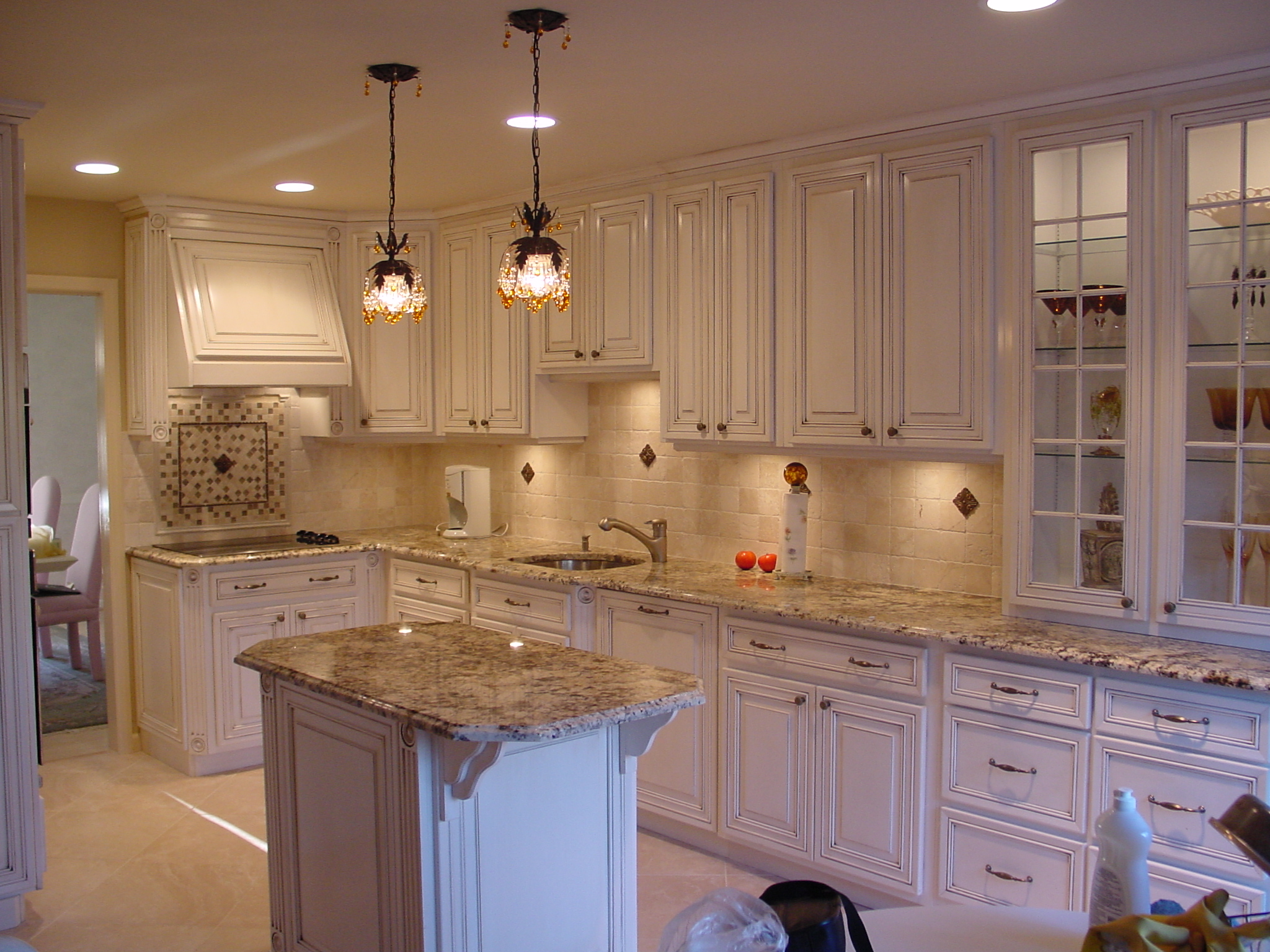 The white kitchen above shows our custom hood and a custom island in Cherry Hill, NJ with kitchen storage solutions for easy meal preparation.