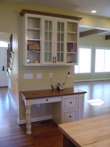 Our custom desk area in the kitchen in West Chester, PA, using available space for organization in this downsize home in the West Chester, Malvern area.