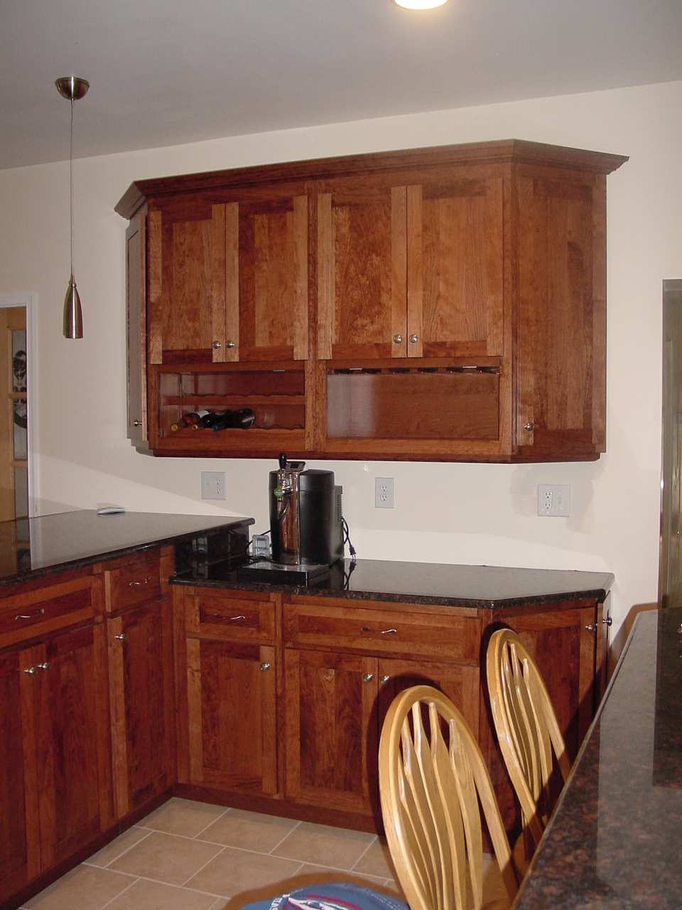 This Doylestown, New Britain, area shows a wall cabinet with wine bottles and glass stems area to give this kitchen a great custom area with all the added convenience to make cooking in your kitchen a pleasure.