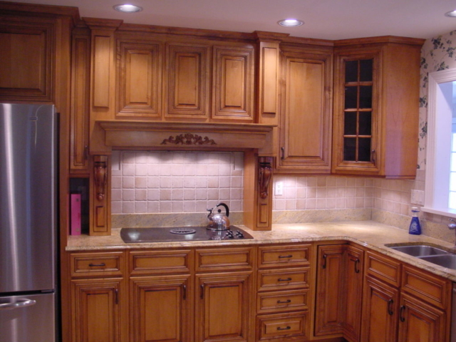 This Mount Holly, NJ home shows a custom wood hood and applied moulding doors.