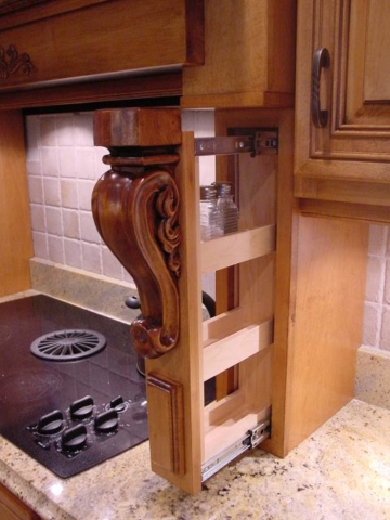This Mount Laurel, NJ, shows custom pull out spice rack, a maple wood hood, giving this kitchen quick access to your most used items in the kitchen.