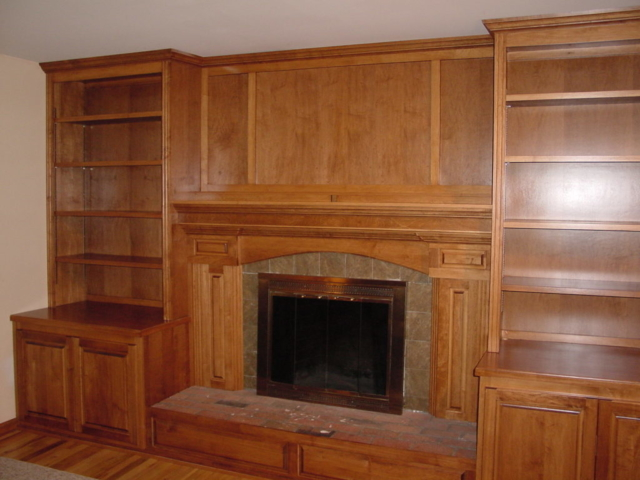 Our custom cherry wood stained cabinets in the family room, fireplaces with built-in bookcases in Upper Makefield, Washington Crossing area of Bucks County gives this large family much-needed storage.