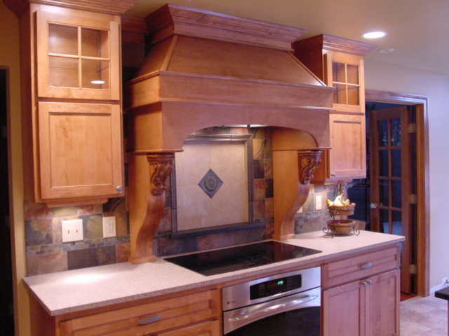 Custom wood hood in Maple Wood stain. Custom double doors with glass mullions and plenty of roll-out shelves. This great kitchen is located in Upper Bucks, Yardley, Lower Makefield area. All new wood kitchen cabinets.